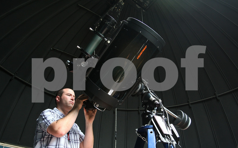 Kyle Bursaw – kbursaw@daily-chronicle.com<br /> <br /> NIU Observatory Manager Matt Wiesner does some maintenance on the eyepiece and guidance systems of the telescope on Thursday, July 7, 2011.