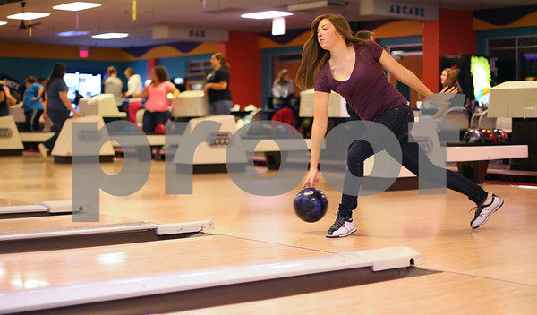 Kyle Bursaw – kbursaw@shawmedia.com<br /> <br /> DeKalb sophomore Maddy Jouris takes a shot during bowling practice at Mardi Gras Lanes on Friday, Nov. 18, 2011.