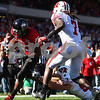 Kyle Bursaw – kbursaw@shawmedia.com<br /> <br /> Jasmin Hopkins (25) runs in for Northern Illinois' only touchdown of the day during the first quarter of the game against Wisconsin at Soldier Field in Chicago, Ill. on  Saturday, September 17, 2011. Wisconsin defeated Northern Illinois 49-7.