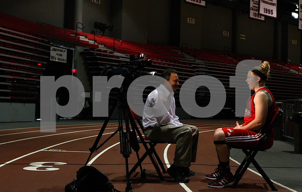 Kyle Bursaw – kbursaw@shawmedia.com<br /> <br /> Northern Illinois guard Courtney Shelton does an interview with a reporter during the school's basketball media day at the Convocation Center on Tuesday, Oct. 25, 2011.