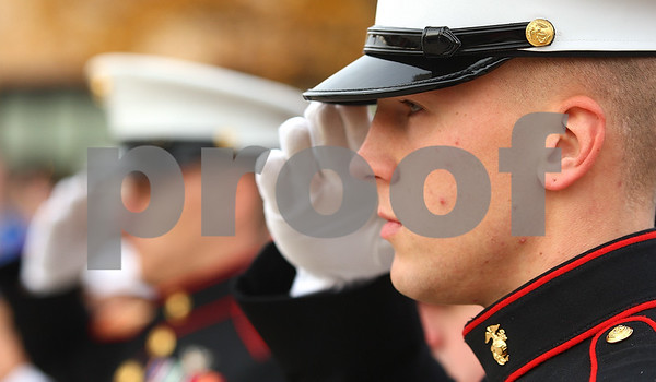 Kyle Bursaw – kbursaw@shawmedia.com<br /> <br /> Lance Corporal Derrick Wells, A marine and 2007 Sycamore graduate, stands at attention as the Sycamore High School choir performs the national anthem during a veterans day ceremony around the flag pole at Sycamore High School on Friday, Nov. 11, 2011.