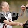 Rob Winner – rwinner@daily-chronicle.com<br /> <br /> DeKalb's Dan Petras is greeted by teammates at the end of the third inning on Monday, March 21, 2011, in DeKalb, Ill. Petras drove in two runs in the inning to tie up their game against Auburn, 3-3.