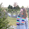 Kyle Bursaw – kbursaw@shawmedia.com<br /> <br /> Ruth Giuliano, of Sycamore, eyes up her selection at Camelot Christmas Tree Farm on Tuesday, Dec. 6, 2011.