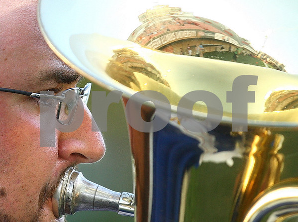 Kyle Bursaw – kbursaw@daily-chronicle.com<br /> <br /> Huskie Stadium is seen reflected in the baritone of Conner Heinle, of Michigan, as he plays a solo before the drum and bugle competition on Saturday, July 30, 2011.