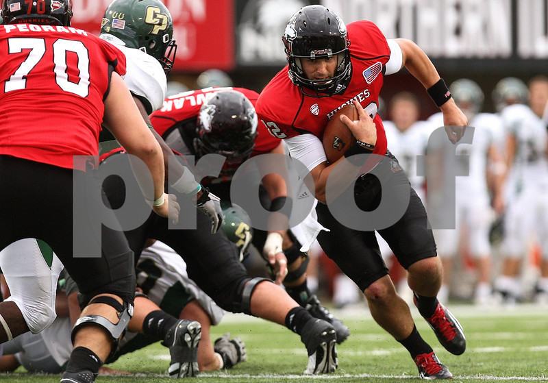 Kyle Bursaw – kbursaw@shawmedia.com<br /> <br /> Northern Illinois quarterback Chandler Harnish (12) looks for a lane in the fourth quarter of the game against Cal Poly at Huskie Stadium in DeKalb, Ill. on Saturday, Sept. 24, 2011.