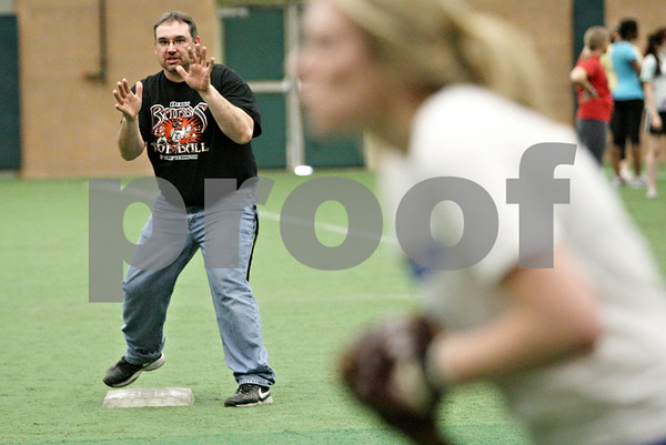 Rob Winner – rwinner@daily-chronicle.com<br /> <br /> DeKalb coach Jeff Davis instructs his players during softball practice at the DeKalb Park District Sports and Recreation Center on Tuesday, March 8, 2011.