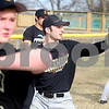 Kyle Bursaw – kbursaw@daily-chronicle.com<br /> <br /> Sycamore senior Trevor Mathey (center) catches a ball as he and the rest of his teammates warm up their arms for baseball practice on Wednesday, March 16, 2011.