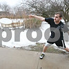 Rob Winner – rwinner@daily-chronicle.com<br /> <br /> Wearing shorts and a short-sleeve shirt Trevor Edmonson tosses a frisbee on the Northern Illinois University campus in DeKalb on Thursday afternoon.