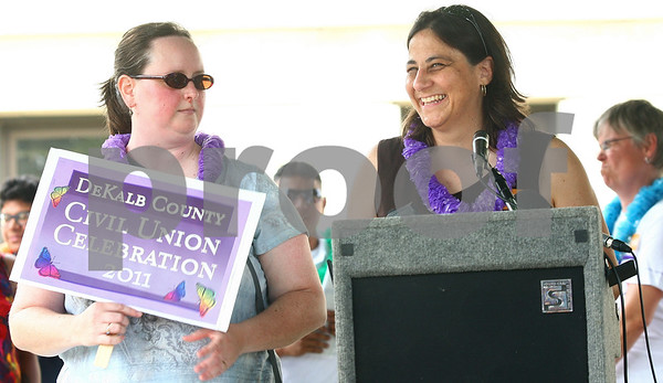 Kyle Bursaw – kbursaw@daily-chronicle.com<br /> <br /> Ann Shult (right) smiles as she speaks of her relationship with partner Sarah Adkins (left) to the crowd at the civil union celebration in front of the DeKalb County Courthouse in Sycamore, Ill. on Friday, July 15, 2011. The couple later took the oath to make their civil union official.