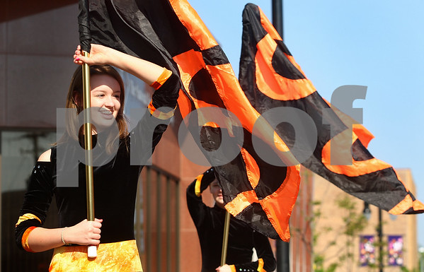 Kyle Bursaw – kbursaw@daily-chronicle.com<br /> <br /> Sarah Trostle, of DeKalb High School, rehearses the color guard routine prior to DeKalb's parade on Monday, May 30, 2011.