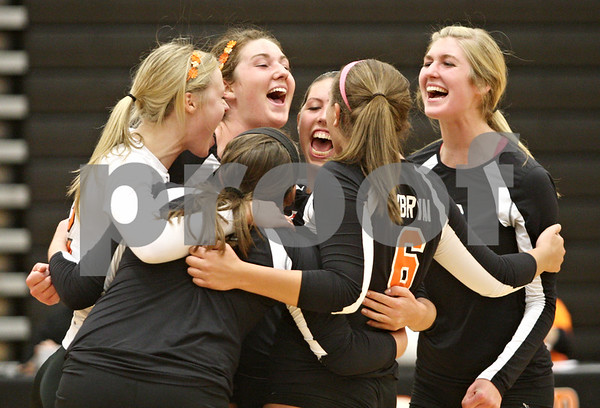 Rob Winner – rwinner@shawmedia.com<br /> <br /> The DeKalb volleyball team celebrates their victory over Sycamore in DeKalb on Wednesday, Oct. 5, 2011. DeKalb defeated Sycamore, 28-26 and 25-19.