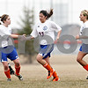 Rob Winner – rwinner@daily-chronicle.com<br /> <br /> Genoa-Kingston's Shannon Schumacher (left) congratulates teammate Julia Mendoza (13) after Mendoza's goal during the first half. G-K defeated Indian Creek, 5-1.