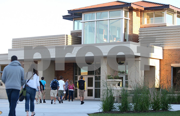 Kyle Bursaw – kbursaw@shawmedia.com<br /> <br /> DeKalb High School students head into the building on the first day of school on Tuesday, Sept. 6, 2011.