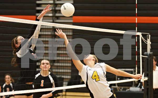 Rob Winner – rwinner@shawmedia.com<br /> <br /> Sycamore's Ratasha Garbes (4) tips a ball over for a point during the second game in DeKalb on Wednesday, Oct. 5, 2011. DeKalb defeated Sycamore, 28-26 and 25-19.