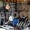Kyle Bursaw – kbursaw@daily-chronicle.com<br /> <br /> Gary Pisarski moves around some of the inventory at Mary's Lending closet, located in the garage at St. John Lutheran Church in Sycamore, Ill. on Thursday, July 28, 2011.