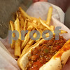 Kyle Bursaw – kbursaw@daily-chronicle.com<br /> <br /> Ashley Hopper dishes fries into a basket with a chili dog at Riccardi's Red Hots & Soda Fountain in Sycamore, Ill. on Friday, May 13, 2011. Riccardi's fries do not have trans fat.