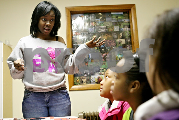 Rob Winner – rwinner@daily-chronicle.com<br /> <br /> Northern Illinois Student Adeola Adetunji works with a group of grade school students at The Rock Christian Church in DeKalb before a presentation on Monday.