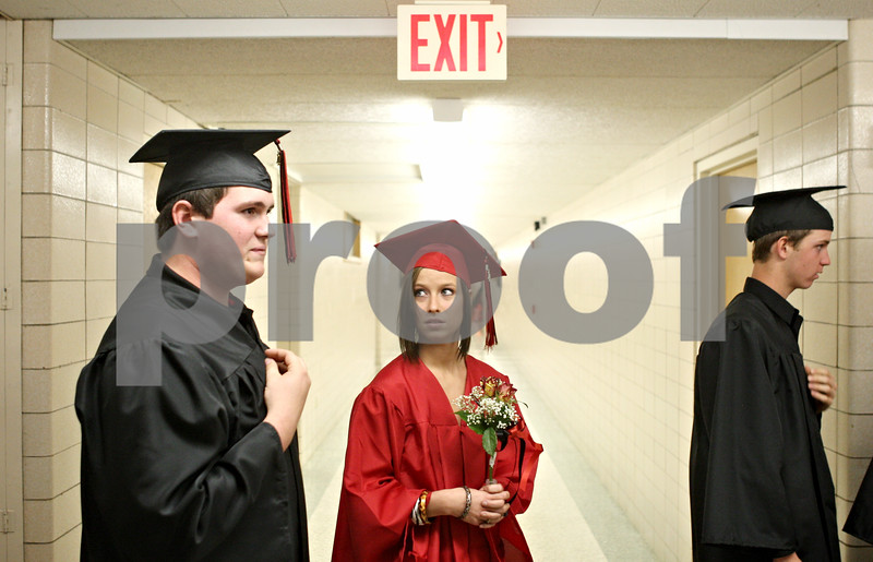 Rob Winner – rwinner@daily-chronicle.com<br /> <br /> Dalton Heyob (left) and Skyla Hubble line up outside the gymnasium before the start of the Indian Creek High School commencement on Sunday, May 15, 2011, in Shabbona, Ill.