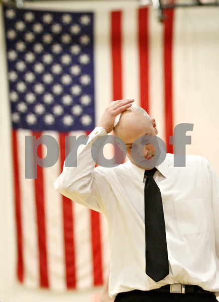 Rob Winner – rwinner@daily-chronicle.com<br /> <br /> Kaneland coach Brian Johnson walks along the court during the fourth quarter of an IHSA Class 3A Sycamore Regional semifinal game on Wednesday, March 2, 2011.