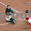 Rob Winner – rwinner@daily-chronicle.com<br /> <br /> Eastern Michigan catcher Sarah Gerber (left) is unable to control a ball allowing Northern Illinois' Erika Oswald to score on a sacrifice fly to left field during the fifth inning on Friday, April 1, 2011, in DeKalb, Ill. NIU went on to defeat EMU in the first game of a doubleheader, 8-6.