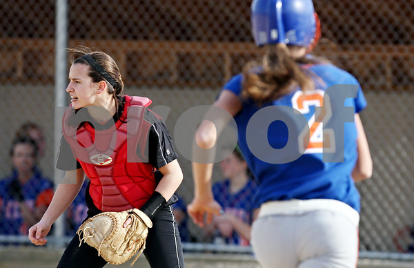 Rob Winner – rwinner@daily-chronicle.com<br /> <br /> Indian Creek catcher Anna Stiker (left) calls for the ball while Genoa-Kingston's Kelsie Campbell (2) scores during the first inning in Shabbona, Ill., on Wednesday, March 16, 2011. Genoa-Kingston defeated Indian Creek, 26-1.