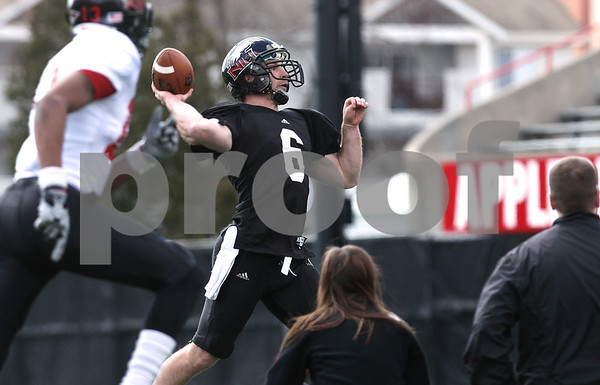 Kyle Bursaw – kbursaw@daily-chronicle.com<br /> <br /> Quarterback Jordan Lynch makes a pass during practice at Huskie Stadium on Saturday, April 2, 2011.