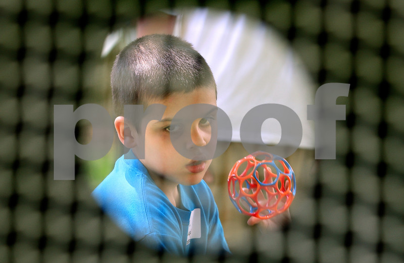 Kyle Bursaw – kbursaw@daily-chronicle.com<br /> <br /> Joseph Schmidt aims for a target at the throwing station at an Illinois Young Athletes event, a Special Olympics program for younger children held at Hallgren Park in DeKalb, Ill. on Tuesday, May 24, 2011.