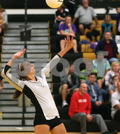 Kyle Bursaw – kbursaw@shawmedia.com<br /> <br /> Kaneland's Kylie Siebert serves during the match at Sycamore High School on Tuesday, Sept. 20, 2011.