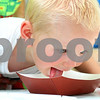 Kyle Bursaw – kbursaw@daily-chronicle.com<br /> <br /> Andrew Johnson, 3, licks up some ice cream during an eating contest. Not yet tall enough to reach the table on his own, he has some help from his father Derek lifting him during the Shabbona Fourth of July Festival on Saturday, July 2, 2011.