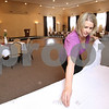 Kyle Bursaw – kbursaw@daily-chronicle.com<br /> <br /> Jill Selimbegovic, co-owner of the Regale Center, sets up a table on Friday, April 8, 2011. The center is located behind MVP Sports Club at 124 1/2 S. California Street in Sycamore, Ill.