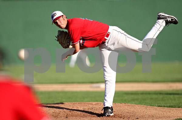 Rob Winner – rwinner@daily-chronicle.com<br /> <br /> On Wednesday evening in Sycamore, DeKalb County pitcher Tyler Dray delivers a pitch during the fifth inning of a resumed game that was suspended due to rain on Tuesday. The Liners lost to Terre Haute, 13-11.