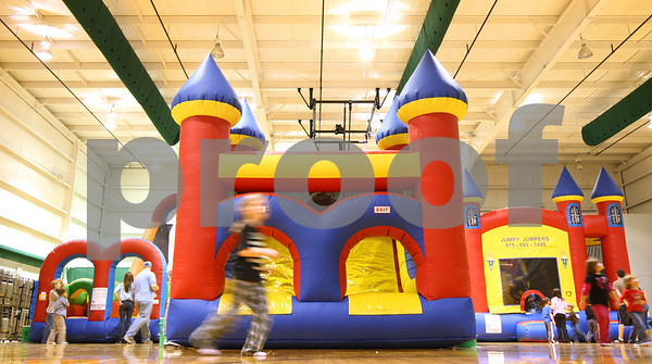 Kyle Bursaw – kbursaw@shawmedia.com<br /> <br /> Children run around the gym at Cornerstone Christian Academy between the six inflatable attractions at 'Jumping Jolidays' hosted by Jumpy Jumpers  on Wednesday, Dec. 21, 2011.