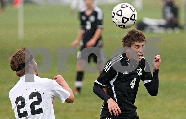 Rob Winner – rwinner@shawmedia.com<br /> <br /> Kaneland's Kushstrim Ismaili uses his head to control a ball during the first half in Sycamore, Ill., on Tuesday, Sept. 27, 2011. Kaneland defeated Sycamore, 2-0.