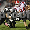 Rob Winner – rwinner@shawmedia.com<br /> <br /> Kaneland's Dylan Nauert (20) and Ryan Lawrence (29) tackle Yorkville's Neil O'Brien after a kickoff during the first quarter in Maple Park, Ill., on Friday, Oct. 7, 2011.