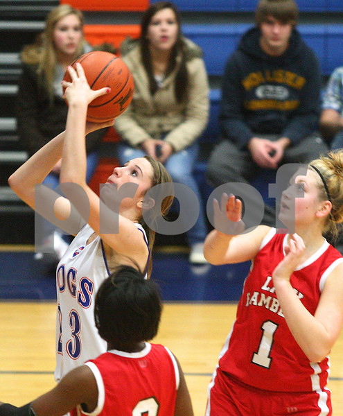 Kyle Bursaw – kbursaw@shawmedia.com<br /> <br /> Genoa-Kingston's Andrea Strohmaier puts up a shot in front of Mooseheart's Arranda Patton (1) in the second quarter of their game in Genoa, Ill. on Wednesday, Dec. 14, 2011