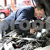 Rob Winner – rwinner@daily-chronicle.com<br /> <br /> Norm Parker, a mechanic at Bockman's Auto Care in Sycamore, looks over a vehicle on Monday afternoon.