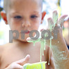Kyle Bursaw – kbursaw@daily-chronicle.com<br /> <br /> Evan Davis, 4, watches 'space mud' slowly drip through his fingers outside the DeKalb Public Library during the Silly Summer Fun event on Wednesday, Aug. 3, 2011.