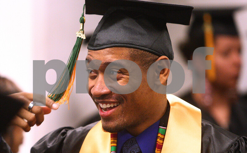 Kyle Bursaw – kbursaw@daily-chronicle.com<br /> <br /> Graduating Kishwaukee College student Arnell Hill adjusts his tassel while in line before the graduation ceremony at Kishwaukee College on Saturday, May 14, 2011.