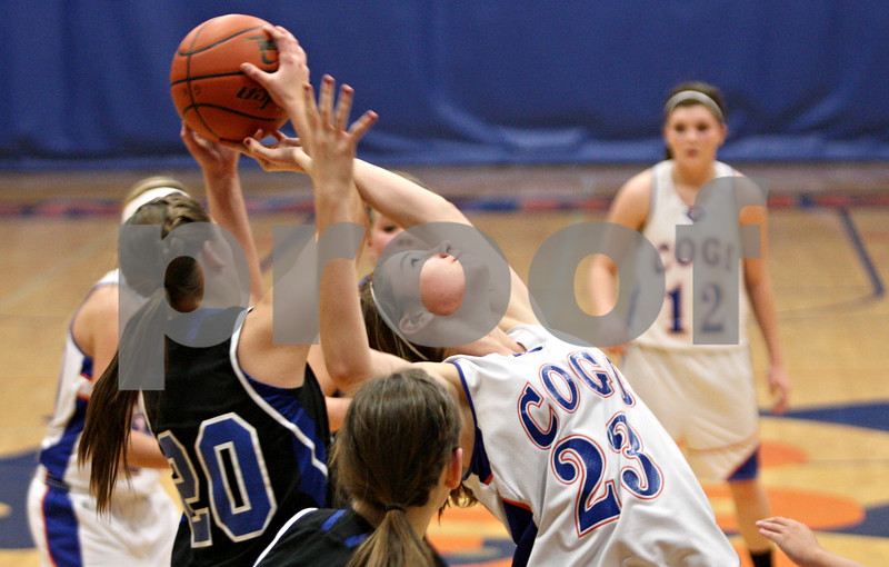 Rob Winner – rwinner@shawmedia.com<br /> <br /> Genoa-Kingston's Andrea Strohmaier (23) tries to reach back for a rebound during the third quarter in Genoa, Ill., on Saturday, Dec. 10, 2011. Westminster Christian defeated GK, 62-25.