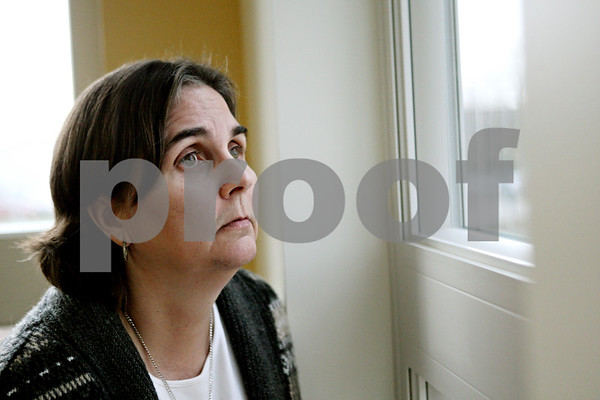 Rob Winner – rwinner@shawmedia.com<br /> <br /> Hope Haven director Leslie Wicks looks outside at a playground from a window inside the new men's dormitory in DeKalb, Ill., on Monday, Nov. 7, 2011. The expansion to the Hope Haven building utilizes the abundance of natural light with numerous windows.