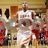 Rob Winner – rwinner@daily-chronicle.com<br /> <br /> DeKalb Andre Harris goes to the basket and puts up two during the first quarter on Friday, Jan. 14, 2011 in DeKalb, Ill.