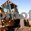 Kyle Bursaw – kbursaw@shawmedia.com<br /> <br /> Richard Larson, of the county highway department, keeps watch on the ground he is reshaping with a road grader in the process of extending the shoulder and widening the ditch on a section of Glidden Road south of Highway 64 on Friday, Oct. 28, 2011.