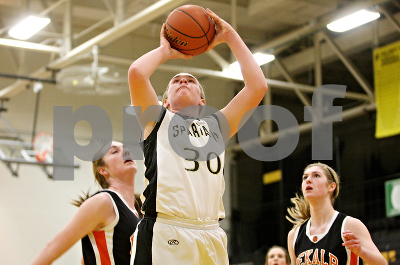 Rob Winner – rwinner@daily-chronicle.com<br /> <br /> Sycamore's Jessica Pluhm takes a shot during the first quarter on Thursday, Feb. 10, 2011 in Sycamore, Ill. Sycamore went on to defeat DeKalb, 34-30.