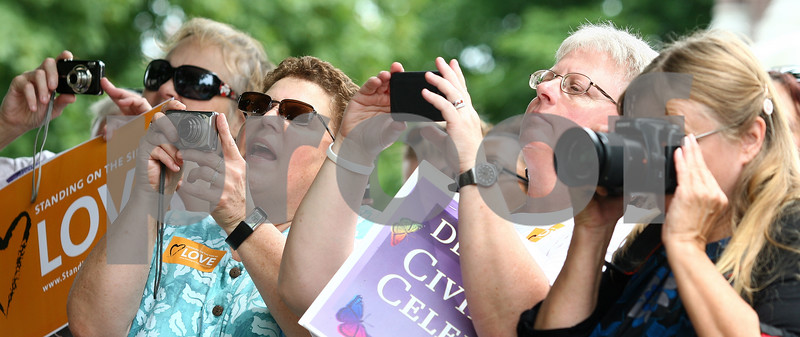 Kyle Bursaw – kbursaw@daily-chronicle.com<br /> <br /> People photograph ten couples making civil union oaths in front of the DeKalb County Courthouse in Sycamore, Ill. on Friday, July 15, 2011.