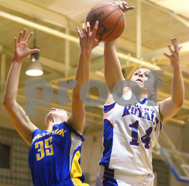 Kyle Bursaw – kbursaw@shawmedia.com<br /> <br /> Hinckley-Big Rock's Kaitlin Phillips (14) and Somonauk's Lauren Brummel (35) try to come up with a rebound during the second quarter of their game in Hinckley on Monday, Dec. 5, 2011.