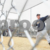 Kyle Bursaw – kbursaw@daily-chronicle.com<br /> <br /> Hiawatha assistant baseball coach Mark Wittwer pitches some balls in the Hiawatha batting cage to one of his players before a game on Wednesday, April 6, 2011. The batting cage and dugouts at the field are dedicated to Wittwer's son, Matt, who died of leukemia in 2010.
