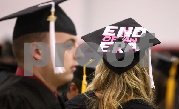Kyle Bursaw – kbursaw@daily-chronicle.com<br /> <br /> Graduating NIU student Ashley Powers displays 'end of an era' on her cap prior to the 9 a.m. ceremony at the Convocation Center in DeKalb, Ill. on Saturday, May 14, 2011