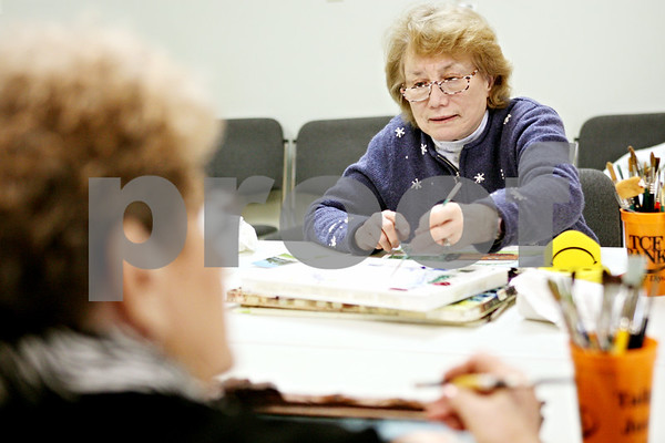 Rob Winner – rwinner@daily-chronicle.com<br /> <br /> Jackie Green (left), of Sandwich, and Joan McEachern, of Yorkville, work on each of their paintings at the Fox Valley Community Center in Sandwich on Thursday afternoon.