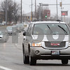 Kyle Bursaw – kbursaw@daily-chronicle.com<br /> <br /> Vehicles on Sycamore Rd use wipers to see through a light rain Wednesday afternoon.<br /> <br /> Wednesday, March 23, 2011.