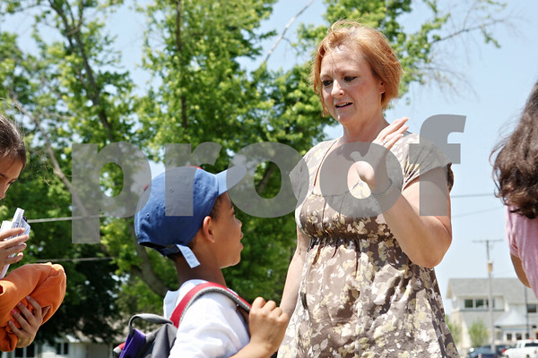 Rob Winner – rwinner@daily-chronicle.com<br /> <br /> Principal Connie Rohlman says good-bye to students boarding a bus during the last day of school at Malta Elementary School on Monday morning.